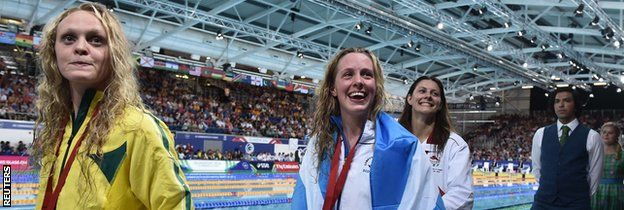 Hannah Miley celebrates her victory in the pool.  Scotland's Hannah Miley earned the first gold medal after obliterating her own Commonwealth Games record in the 400m medley in Glasgow.  The 24-year-old from Inverurie clocked four minutes 31.76 seconds to improve on the new mark of 4:38:27 she set in the heats on Thursday morning.  England's Aimee Willmott, 21, from Middlesbrough, led for the first 350m but was overhauled in the final leg and had to settle for silver.