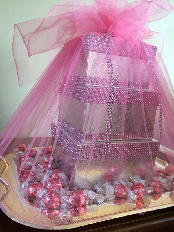Silver & pink shirni boxes & tray filled with chocolates & nuqul. Used for Afghan engagements. Made by arosidecor