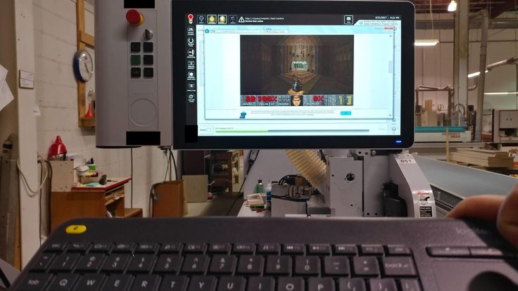 What do you do with a half million dollar industrial machine while waiting for it complete a backup? You play Doom 2 on it.