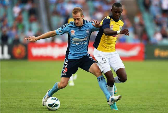Nathan Sherlock fights for the ball in a do or die fixture for Sydney FC v Central Coast Mariners