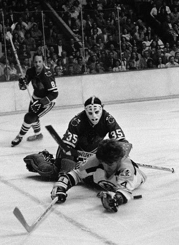 If you can't beat em', take em' down, as Chicago's Tony Esposito tackles Orr, with Jim Pappin looking on.