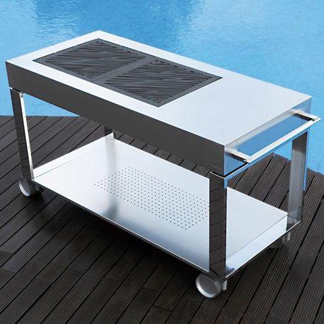 Tacora de Fesfoc, c'est un meuble barbecue design tout inox conçu comme une cuisine extérieure. Performances, deux foyers charbon, roulettes, le top des BBQ