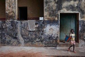 FTA: Joe Penney: A girl leaves a colonial-era building on the island of Bolama
