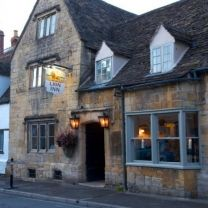 The Lion Inn in Winchcombe is another one of Michelin inspectors' favourite pubs in Gloucestershire. It started as a coaching inn in the 15th Century and now has a  bar, snug, restaurant, garden and en-suite bedrooms. The menu changes frequently based on what is fresh and available. Their current menu features pub favourites such as Slow Cooked Pork Belly, Pan-fried Supreme of Duck and Lamb Rump. The bar offers a good selection of wines, handpicked ales and ciders and their very own…
