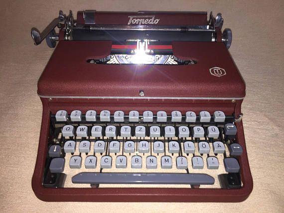 Torpedo de la máquina de escribir mecánica de cereza oscuro de