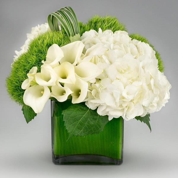 Jadis | A modern arrangement of white hydrangeas, calla lilies, green dianthus…