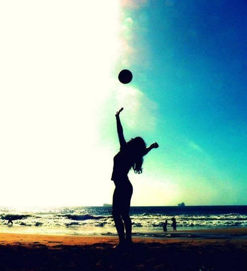 Play beach volleyball summer and spring break