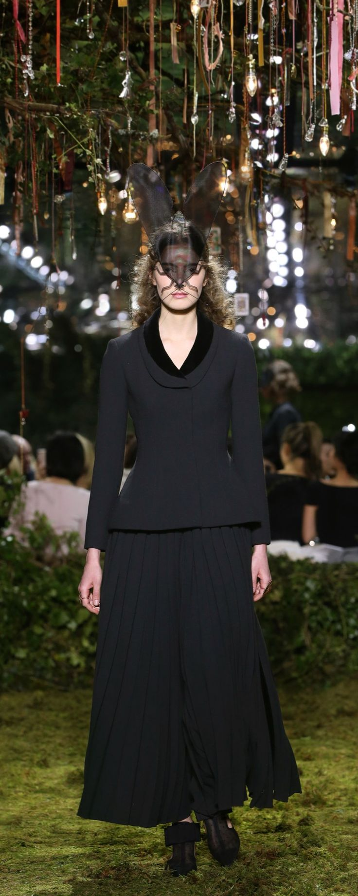 "Christian Dior Official pictures, S/S 2017 - Couture - ""Transformation sublime"" - Black suit jacket with slit and pleated back and pleated pant, after an archival Dior design. Fly mask in crinoline. - http://www.orientpalms.com/Christian-Dior-6609"