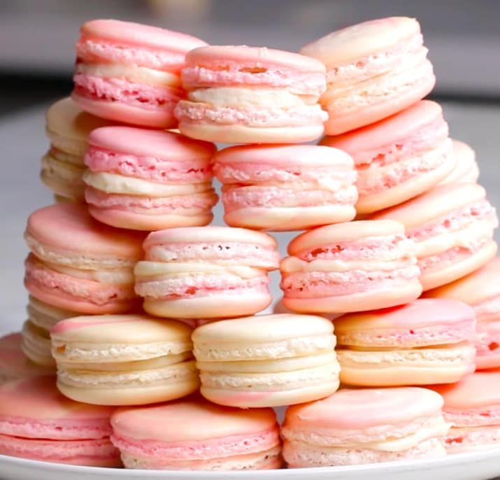 Servings: 16INGREDIENTS3 eggs whites, room temperature¼ cup sugar1¾ cup powdered sugar1 cup superfine almond flour3 drops red food coloringFilling:1 8-ounce package of cream cheese1 cup powdered sugar2 tablespoons milkStrawberry jamPREPARATION1. Preheat oven to 285ºF/140ºC.2. In a medium bowl, beat the egg whites until frothy.3. Keep beating and slowly add sugar until stiff peaks form.4. Sift powdered sugar and almond flour over the egg whites.5. Fold the dry mixture into the egg whites…