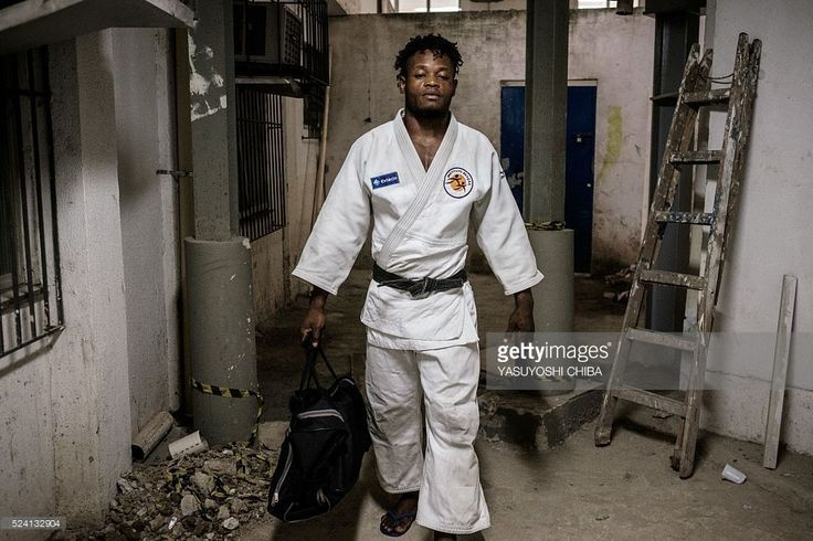 Popole Misenga, 24, a refugee judoka from the Democratic Republic of Congo, wears his judogi before a training at Instituto Reacao in Rio de Janeiro, Brazil, on April 14, 2016. Misenga is a strong candidate for the newly created Refugees Olympic Athletes team for the Rio 2016 Olympic Games. The Congolese athlete --who has been split from his family due to the civil war in Congo since he was ten years old-- decided to stay in Brazil during the World Judo Championshio in 2013 together with…