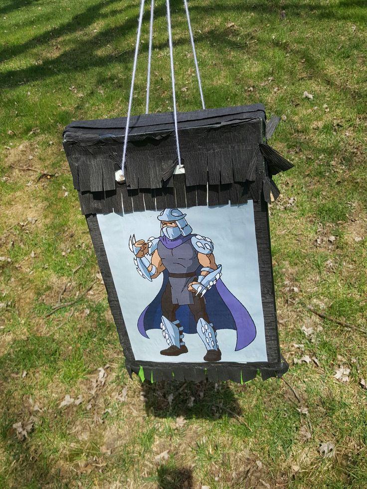 Ninja turtle (Shredder pinata) Homemade!  -Old Kohls gift box -streamers -printed photo of bad guy