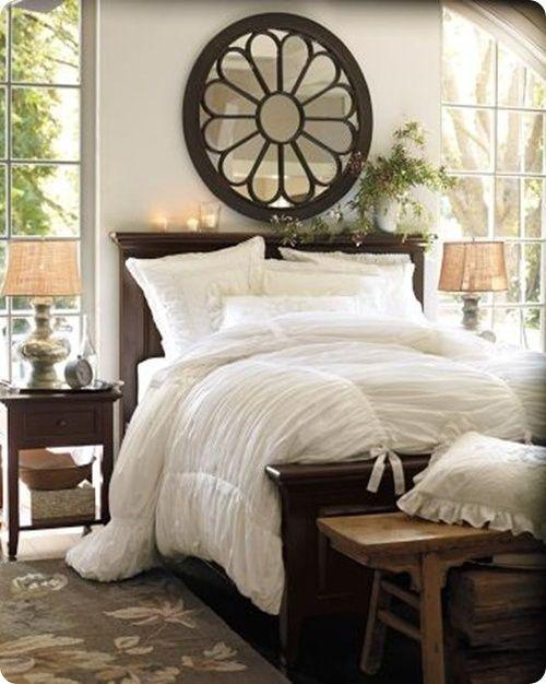 LOVE white bedding with dark bedroom furniture