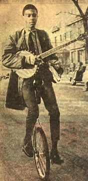 Otis Taylor on a unicycle...playing a banjo. This could be me! Lol he's got my ride!