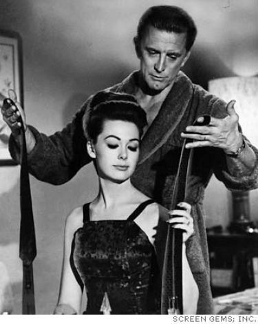 STRANGERS WHEN WE MEET (1959) - Kirk Douglas & Barbara Rush - Columbia Pictures - Publicity Still.