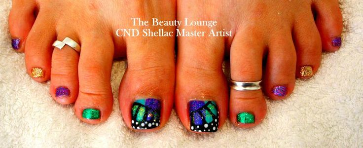 CND Shellac toes in Butterfly style print. Purple and Green with Glitter.  #cndshellac #nailart #salcombe #butterflies