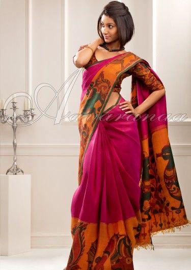Trendy dark pink kancheepuram sari with kalamkari border..