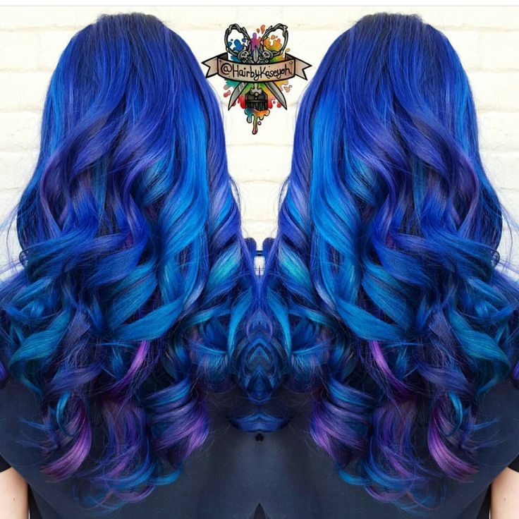 Beautiful blue and purple hair on long curly hair by @hairbykoh vivid hair blue hair color Long hair hotonbeauty.com