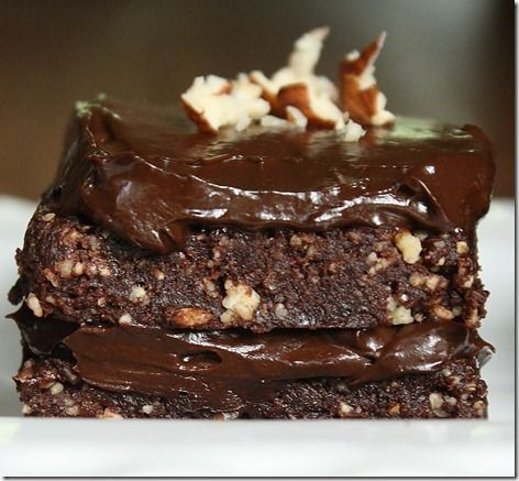 Hazelnut Chocolate Cake {Raw/Vegan}    Prep time: 20 minutes    Cook time: 0 minutes    Ingredients(makes 5 2×3-inch frosted cakes):    2 cups hazelnuts  1 cup pitted dates  3/4 cup cocoa powder, divided  1/2 cup + 2 tablespoons maple syrup, divided  1 medium avocado  Crushed hazelnuts for garnish