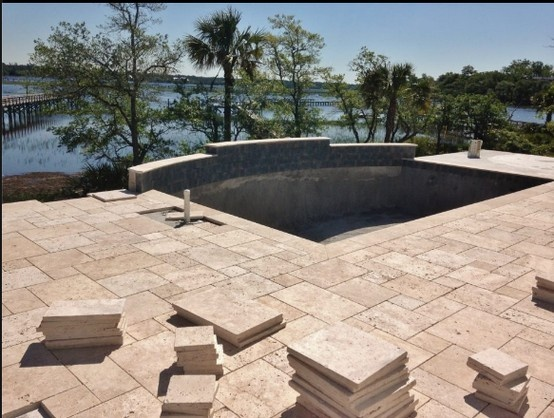 travertine marble set in the versaille pattern on this pool deck