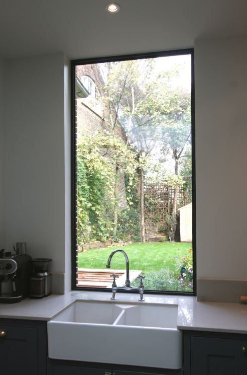 Fixed aluminium casement window over the kitchen sink to maximise natural light in the open plan living spaces.