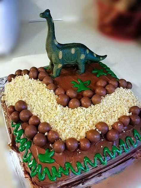 DIY dinosaur cake. Frosting, crumbled up vanilla Oreo cookies, and whoppers! Add any Dino toy!  Easy!!