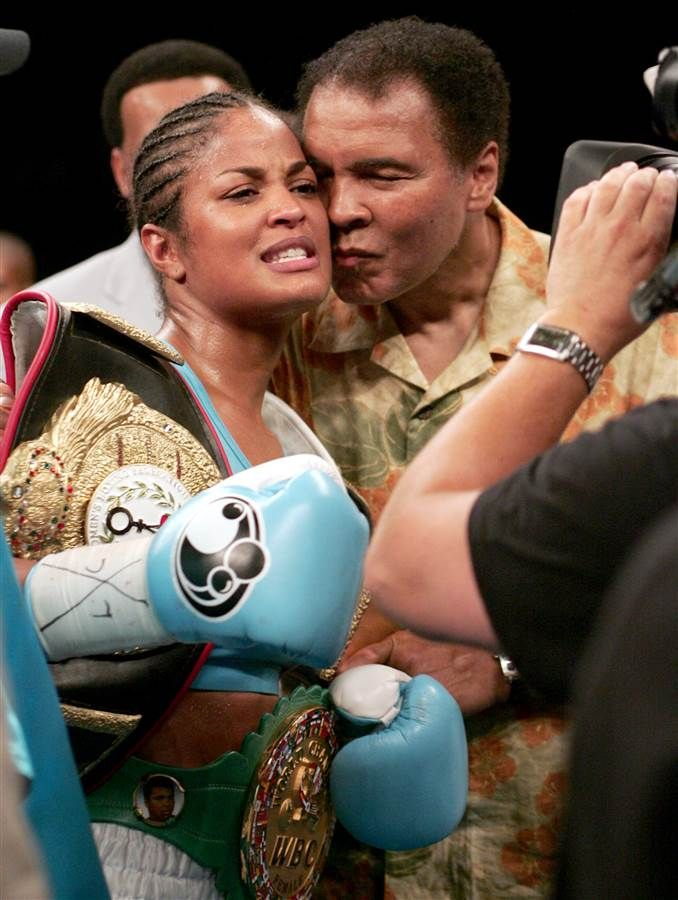 WIBA Super Middleweight Champion Laila Ali is kissed by her father, boxing legend Muhammad Ali, following her third round TKO victory on June 11, 2005 at the MCI Center in Washington, D.C. PAUL J. RICHARDS / AFP-Getty Images file