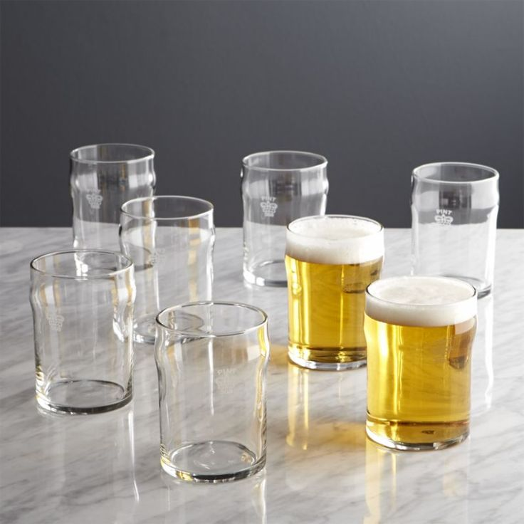 Shop Set of 8 Half Pint Glass Tumblers with Crown. A traditional crown marks these English-style pub glasses as an official imperial pint and a petite half-pint.