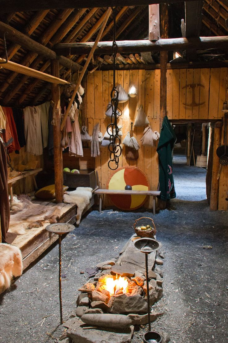 Viking long house with a stone-lined hearth in the middle. A fire was kept for cooking and heating and the smoke escaped through a hole in the roof. The hall was often smoky and smelly. The floor of the hall was made of hard-packed earth, covered with ree