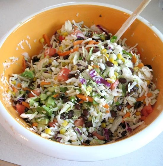Mexican Coleslaw: 1 package Slaw Mix 1 can corn {drained} 1 can black beans {drained} 1/3 cup diced green onions 1 cup diced tomatoes 1/2 cup diced black olives 1/4 cup diced cilantro 1 avocado chopped 3/4 cup Jalapeno Ranch Dressing Garnish with cilantro.