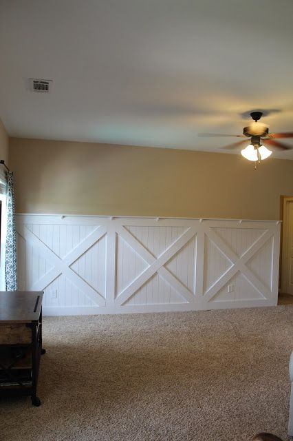 Barn door wainscoting wall treatment Tutorial remodelaholic.com #wainscoting #barn Door