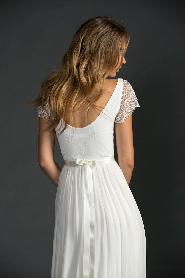 Clare is one of those dresses that just looks stunning on everyone. Featuring a flattering shape with stretch Swiss embroidery at the torso with a scooped neck and back complimented by whimsical beaded statement sleeves. Hugging the body to the waist which is met with a simplistic silk chiffon skirt and an optional train. Complete …