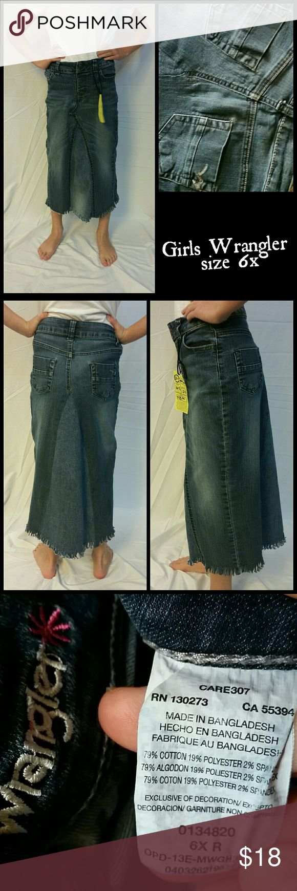 """Girls Wrangler long jean skirt. Size 6x. Modest. Great skirt! Frayed hem won't roll so it's wash and go and perfect for school mornings! Size 6x. Measurements taken when lying flat: waist 11 1/2"""" hips 13"""" length 24"""". Note picture 4: waist has been taken in slightly and can be let out. Wrangler Bottoms Skirts"""