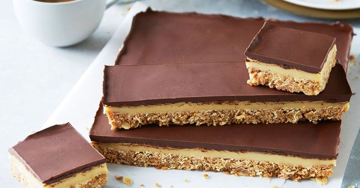 Anzac biscuits add a chewy coconut texture to this irresistible chocolate and caramel slice.