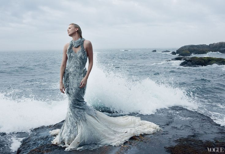 Charlize Theron, Photographed by Annie Leibovitz for VOGUE  She blends into the waves so beautifully it is as though she is part of nature. Amazing