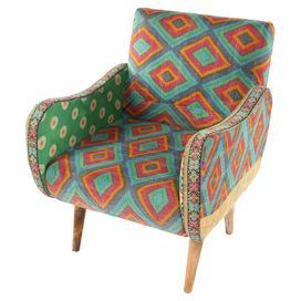 """Bring eye-catching bohemian style to your living room seating group or den ensemble with this mango wood-framed arm chair, showcasing vibrant patterned upholstery and curving arms.   Product: ChairConstruction Material: Mango wood and cottonColor: MultiFeatures:  HandmadeHardware includedDimensions: 33"""" H x 27"""" W x 28"""" DCleaning and Care: Spot clean"""