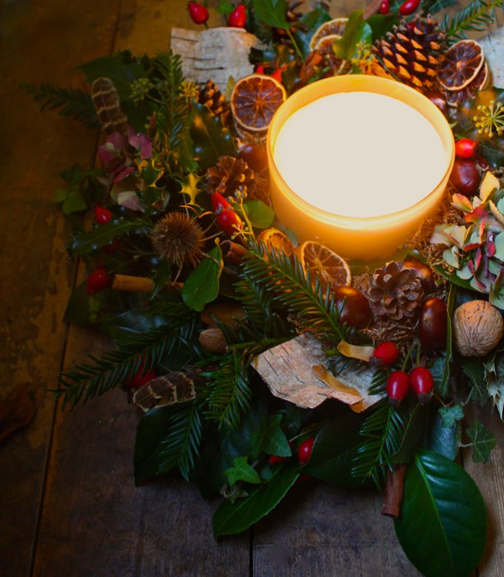 Glowing Christmas table centre. Natural wreath with multi wick candle.