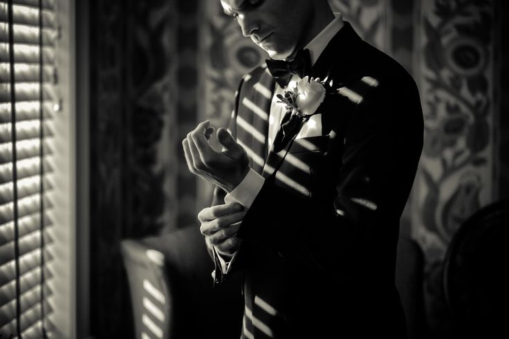 I love the use of light and shadow in this photo of the groom getting ready.