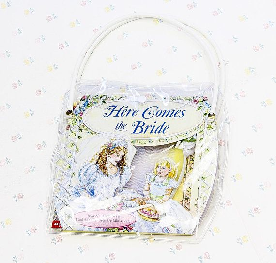 """""""Here Comes the Bride"""" - A book & bridal play set for kids, unused in original package! Contains everything that imaginative little girls need to prepare for the special day. The kit includes: - Here Comes the Bride storybook by Marie Orgera, 1996 Scholastic - 8 pairs of stick-on"""