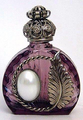 Frasco de perfume.                                                                                                                                                                                 Más