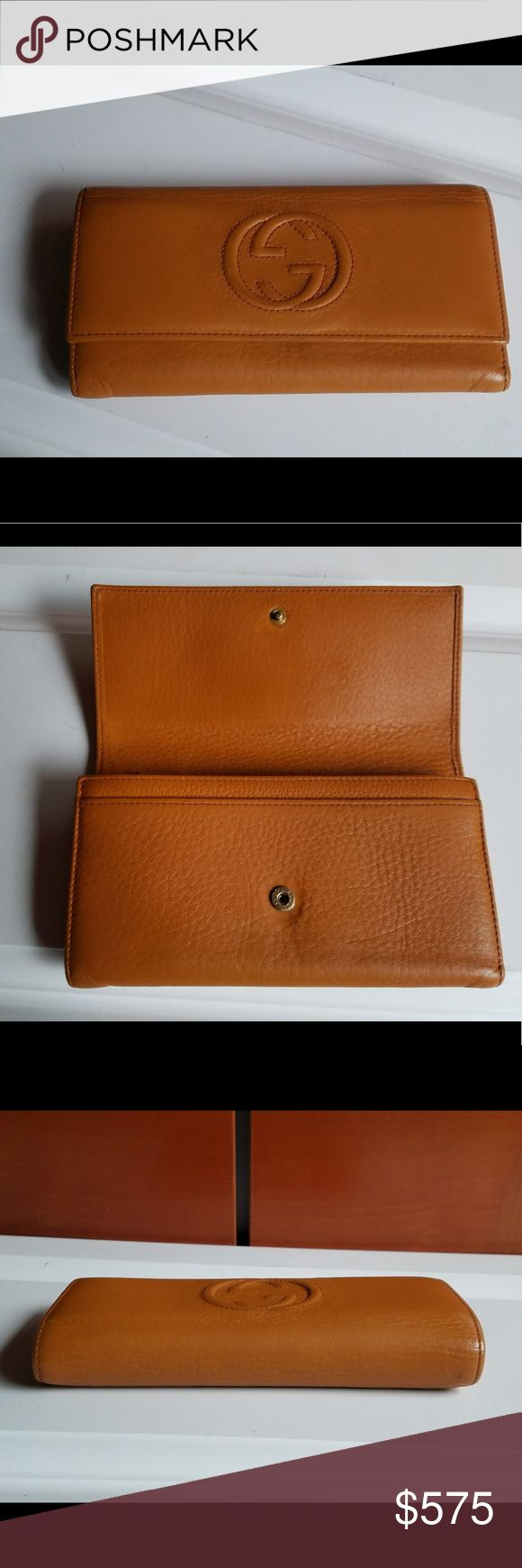 GUCCI SOHO LONG WALLET DARK tan/orange color Gucci soho wallet Very. Good used condition as shown on pict orange color  but to me color looks more like deep tan pict are taken in natural light without flash so represented way it actually look snap closure many different compartments inside as shown pict of serial #included  also has been professionally authenticated since received as gift will come with papers of authenticity7 1/2 inch wide 4 inch tall  1inch thick  wallet Is on heavier…