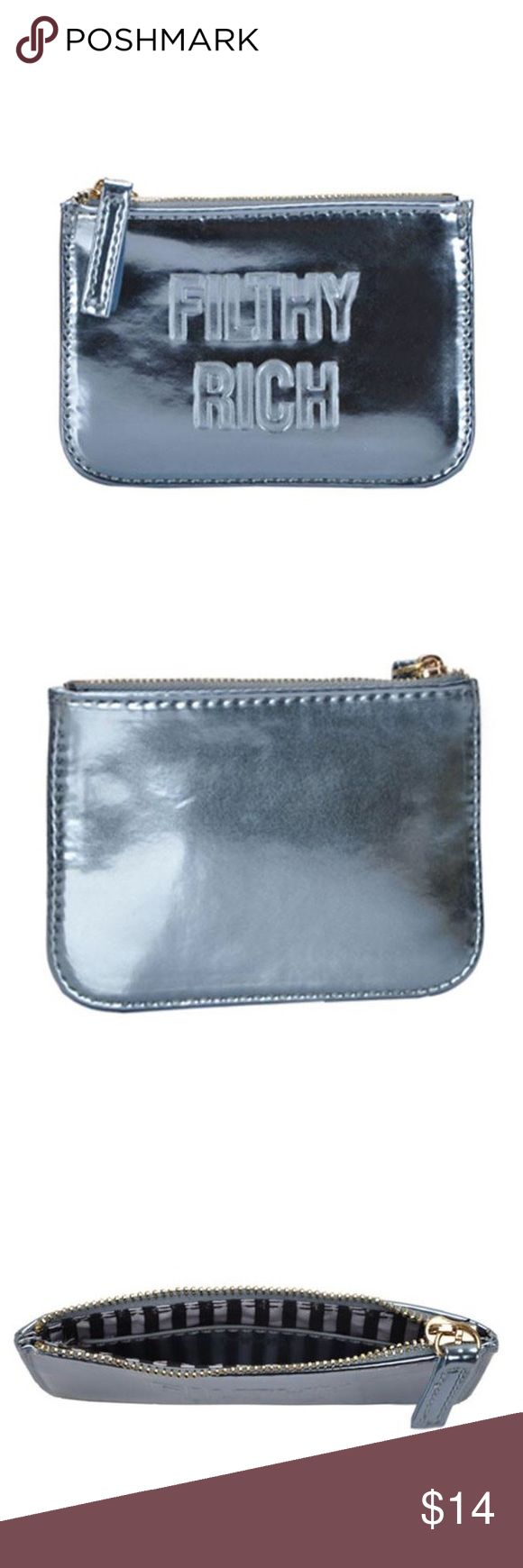 "Filthy Rich Metallic Coin Purse Stash your cash in this nifty little pouch for your next spending spree! Flat, rectangular wallet highlights a shiny metallic exterior that features ""Filthy Rich"" in stamped, capitalized typeface. Zip-top opening reveals a lined interior with an open sidewall pocket.  Length: 3.5"", Width: 5.25"", Depth: 0.5"" Man made materials MMS Design Studio Accessories"