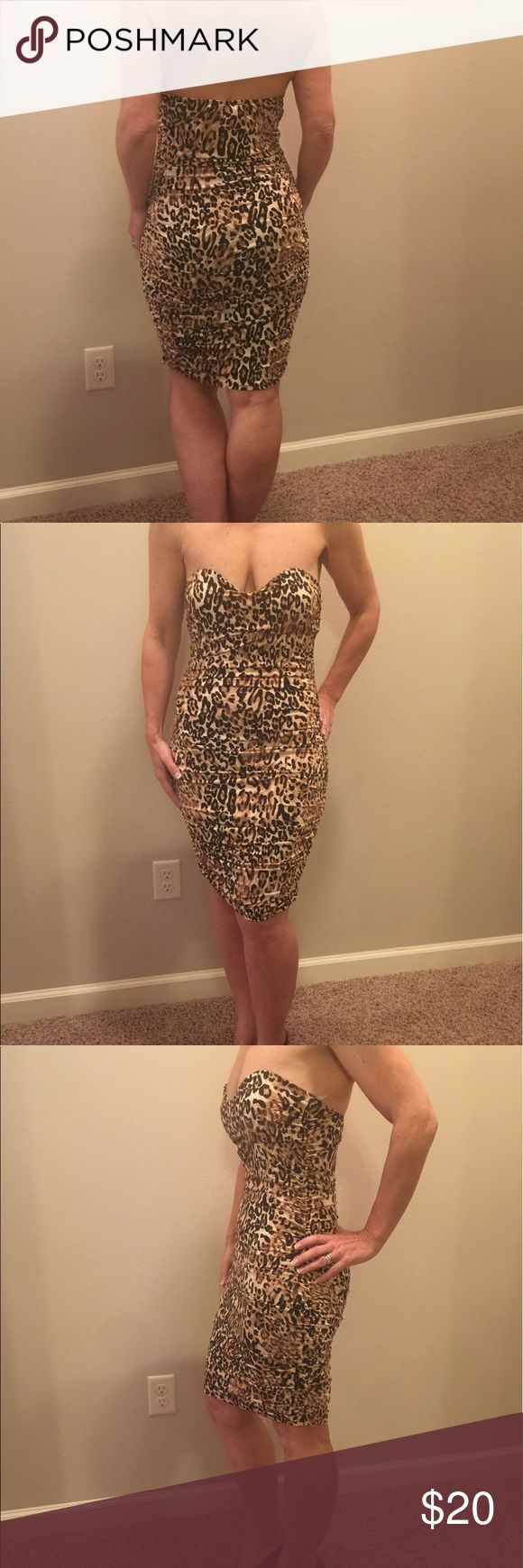 Animal print dress This dress is an eye catcher!!! Can you guess why I am selling it!!?? Not enough (@)(@) to hold her up!!☺️ this wild cat needs a night out on the town!! PUSH THE BUTTON and I will ship her right to you!!! Cristina Dresses Strapless