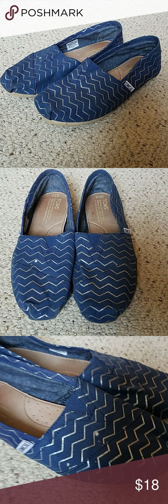 Toms size 7.5 Adorable blue and metallic silver chevron toms in size 7.5.  These shoes are in good used contition, the only flaws are a few very small white spots (pretty hard to notice due to the design of the facric) on the front of the right shoe, see pictures. Toms Shoes Flats & Loafers