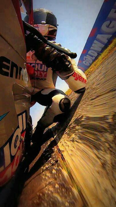 motorcycle driver elbow and knee dragging on the race track