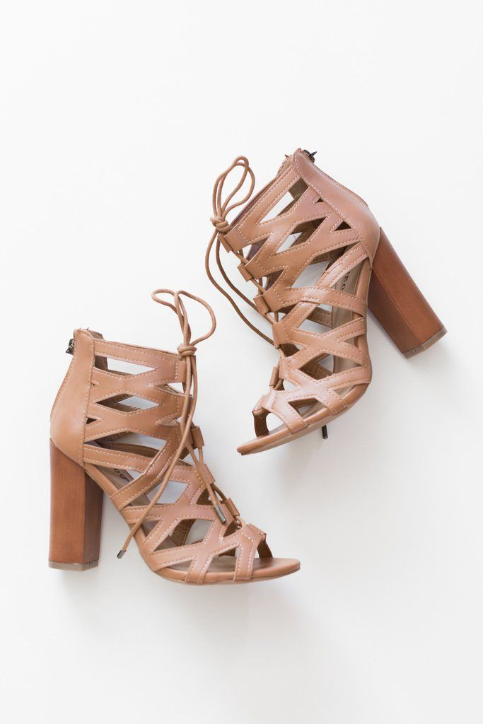 """Nude/Tan lace up heels with bow-tie closure. Back zipper for easy on and off closure. Heel height measures approx. 4"""". Lightly padded insole with a rubbed sole. - All man made material - True to US si"""