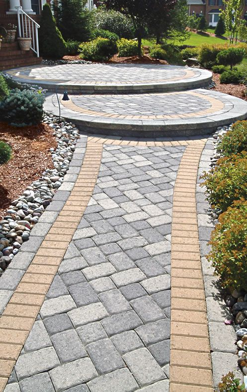 Grinnell spartan paver holland border and circle kit for Paving stone garden designs