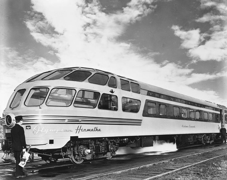 "1948 publicity photo of a Chicago, Milwaukee, St. Paul & Pacific Railroad ""Skytop"" lounge car. The Milwaukee's streamlined Hiawatha passenger trains featured a variety of distinctive observation cars. The fourth and final design was the Skytop Lounge, styled by industrial designer Brooks Stevens and produced by the Milwaukee Shops in 1948. The cars' round ends were 90% glass and included 24 revolving chairs, plus a drawing room."