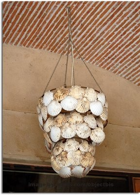 NAUTICAL THEME: shells on a light shade - this would be a fun project to make as you could collect the shells on holidays. Drill a hole in the shells and attach to the metal frame with fishing nylon.