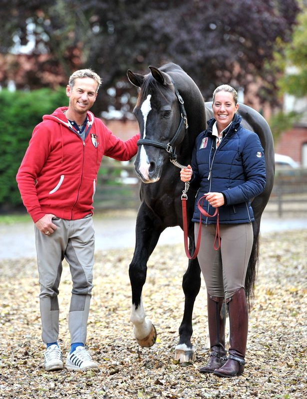 Carl Hester and Charlotte Dujardin with horse, 'Valegro' He's wearing breeches. What a man.
