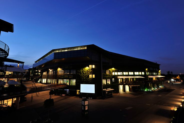 Centre Court is shown as night falls over the All England Lawn Tennis & Croquet Club. - Chris Raphael/AELTC